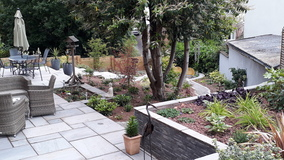 Alison Bockh Garden Design and Landscaping - North Devon - Patio space - hard landscaping and steps to pond at bottom