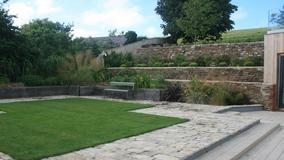 Alison Bockh Garden Design and Landscaping - North Devon - Lawn area over 5 car garage and raised beds