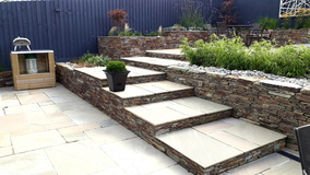 Alison Bockh Garden Design -  Generous new steps reusing stone from original gabians
