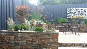 Alison Bockh Garden Design - Reused stone and painted fencing